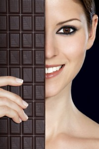 A beautiful woman holding a bar of chocolate